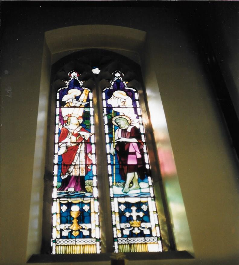 stained glass window behind alter